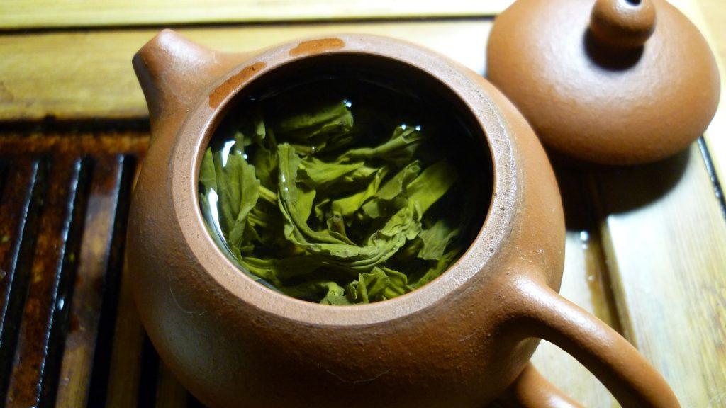 green tea soaking in clay pot