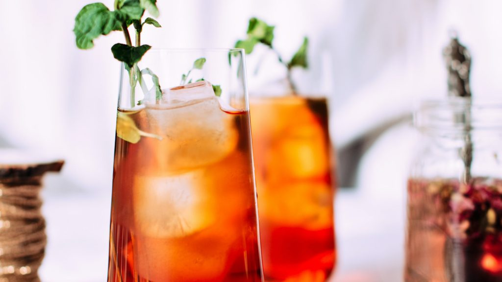 two glasses of iced tea that look delicious